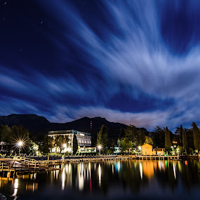 The moving sky. by Mattia Bonavida - Landscapes Starscapes ( clouds, scape, garda, colors, lake, tourism, lago, lights, amazing, mountains, di, night, place )