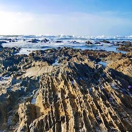 Rocks on the beach by Carmen Bouwer - Nature Up Close Rock & Stone ( nature, blue, artistic, ocean, lines, beach, rocks )