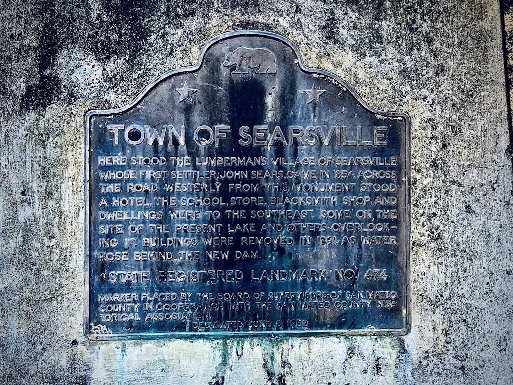Here stood the lumbermen's village of Searsville whose first settler, John Sears, arrived in 1854. Across the road, west of this monument, stood a hotel. The school, store, blacksmith shop, and ...