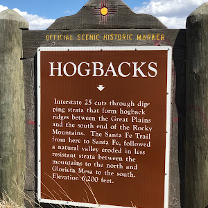 НOGBACKS Interstate 25 cuts through dip- ping strata that form hogback ridges between the Great Plains and the south end of the Rocky Mountains. The Santa Fe Trail from here to Santa Fe, followed a ...