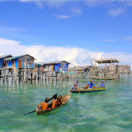 by Alvin Ngow - Landscapes Travel ( moods, innocent, fishing village, people, together, borneo, asian, sabah, sky, nature, village, semporna, family, travel locations, tourism, malaysia, kids, relaxing, waterscapes, fishing boat, holiday, sampan, sea gypsy, mood factory, children, carefree, landscape, water house, photography, island, clear, child, blue sky, life, transport, poverty, asia, gypsies, bajau laut, water, houses, sea, enjoy, seascape, boat, young, wooden, blue, background, outdoor, island hopping, landscapes,  )