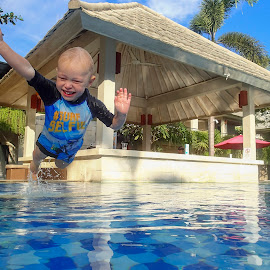 Diving by Geoffrey Wols - Babies & Children Children Candids ( water, pool, happy, swim, dive, action, resort, fun, diving, boy )