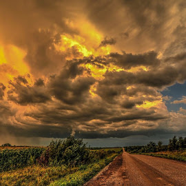Sun trying to peek through  by Casey Mitchell - Landscapes Prairies, Meadows & Fields ( clouds, roads., sunset, storm, country )