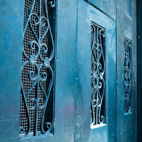 Iron Scrollwork in historic doors by Gwyn Goodrow - Buildings & Architecture Other Exteriors ( doors, new orleans, blue, scroll, outdoors, street, aqua, iron,  )
