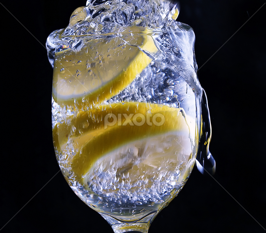 lemon slices by Ismed  Hasibuan  - Food & Drink Fruits & Vegetables ( water, foods, fruits, bubbles, yellow, lemon )