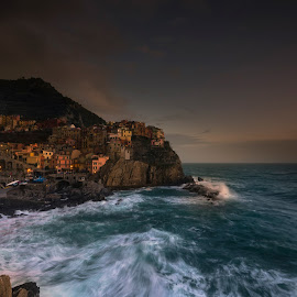Manarola Sunset by Fausto Meini - Landscapes Sunsets & Sunrises ( sky, waves, sunset, sea, night, cityscape, landscape, light, italy, rocks, sun, city )