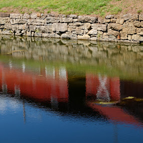 Afternoon Reflections by Jim Schlett - City,  Street & Park  Historic Districts ( farm, sky, red, barn, blue, reflections, river )