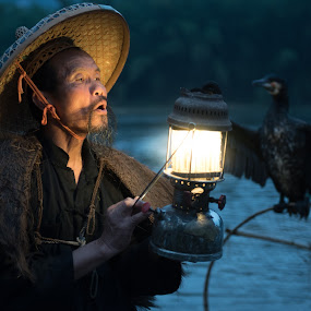 Man with Lantern by Jim Harmer - People Street & Candids ( lantern, straw hat, china )