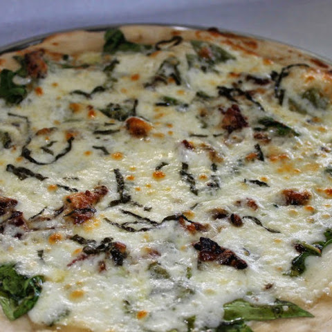 White Sauce Pizza With Bacon and Fresh Greens