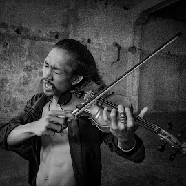 Violinist by Indrawan Ekomurtomo - Black & White Portraits & People