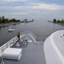 Leaving Muskegon entering lake Michigan. by John Dodson - Transportation Boats