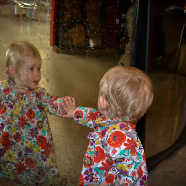 Toddler at fairground mirror by Craig Payne - Babies & Children Hands & Feet ( mirror, hands, fairground, toddler, flowers )