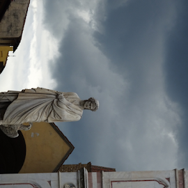 No umbrella big enough by Brian  Boyle - City,  Street & Park  Historic Districts ( brianboyle, marble, statue, florence, photograph, #brianboylephotograph, storm cloud, cloud, #brianboyle14, bb, photography, historic, yukonbrianboyle )