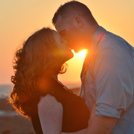 Sunset Kiss by Terri Cox - People Couples ( kiss, sweet, silhouette, woman, sunset, romantic, sunshine, couple, man )