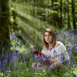 Ramona in the woods by Brian Pierce - People Portraits of Women ( reading, bluebell, spring, woods, rays )