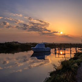 Rising Sun by Abílio Neves - Landscapes Prairies, Meadows & Fields ( sunrise, clouds, sun, water, boat )