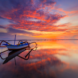 Morning Reflection by Yudik Pradnyana - Landscapes Cloud Formations ( red, bali, sunrise, reflection, light, waterscape, jukung, landscape, morning )