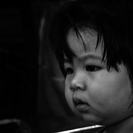 Innocence by Jamaluddin Abdul Jalil - Babies & Children Children Candids ( beautiful scene, headshot, monochrome, scruffy, black and white, thailand, children, candid, street scene, people, beautiful child, portrait, playing, child, girl, lifestyle, playtime )
