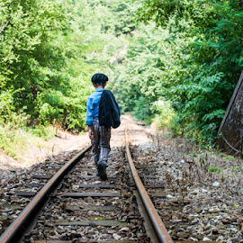 Child walking on railway by Deyan Georgiev - Transportation Trains ( walking, person, railroad, way, little, travel, cute, people, caucasian, kid, child, nature, rail, train, childhood, lonely, track, young, rural, away, railway, outdoors, boy, walk, small )
