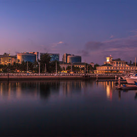 Dusk at Labuan Waterfront by Ithni Shaari - City,  Street & Park  City Parks ( panoramic view, lights, blue sky, sky, waterscape, boats, buildings, streets, relaxation, landscape, city, nightscape )