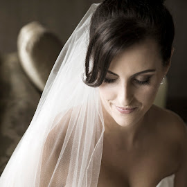 Taking a Moment by Laura Ushay - Wedding Bride ( love, wedding gown, soft lighting, happy, wedding, getting ready, bride, best female portraiture )