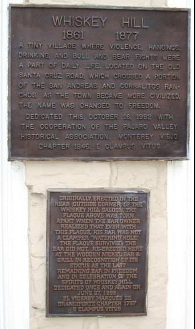 Upper Plaque:   Whiskey Hill 1861     1877 A tiny village where violence, hangings, drinking, and bull and bear fights were part of daily life. Located on the old Santa Cruz Road, which crossed a ...