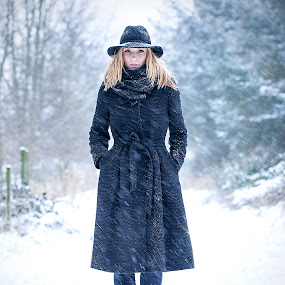 Nevermind the snow.. by Sorin Bogdan - People Portraits of Women ( look, winter, woman, snow, 2012, frozen, black )