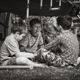 In the Den by Dan Horton-Szar ARPS - Babies & Children Children Candids ( playing, monochrome, black and white, boys, children, den, garden, brothers )
