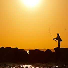 by Jan Gorzynik - Landscapes Sunsets & Sunrises ( person, warm, silhouette, catch, beach, travel, coastline, landscape, recreation, coast, island, sky, nature, pole, angler, mediterranean, dalmatia, light, evening, man, water, hook, beautiful, hobby, sport, sea, horizon, tourism, leisure, lake, seascape, boat, dusk, vacation, bay, sunset, outdoors, summer, sunrise, fishing, view, fisherman )