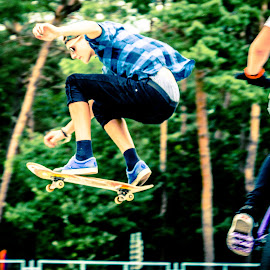 Flying high. by Roger Hamblok - Sports & Fitness Skateboarding ( skateboarding, shades, skaters, fly, lommel, sport, trees, youth, skating, board, woods, skatepark )