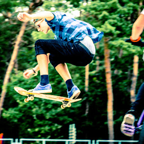 Flying high. by Roger Hamblok - Sports & Fitness Skateboarding ( skateboarding, shades, skaters, fly, lommel, sport, trees, youth, skating, board, woods, skatepark,  )