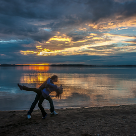 Sunset Dance! by Jesus Giraldo - People Couples ( clouds, reflection, nature, colors, sunset, lake, couple, beauty, dance )