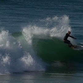 Man surfing by Jack Tindall - Sports & Fitness Surfing