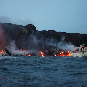 New Year's Day 2013 - Pele's Lava ocean entry by Venetia Featherstone-Witty - News & Events Weather & Storms ( hawaii island, volcano. molten lava flows into the sea, lava eruptions, kilauea, lava boat close to molten lava, volcanic birth of new land,  )