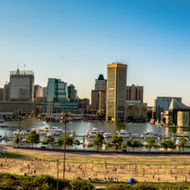 View of Inner Harbor from Federal Hill by Jackie Nix - City,  Street & Park  Skylines ( baltimore, city, entertainment, maryland, tourism, towers, urban landscape, highrises, view, piers, inner harbor, cityscape, bay, park, sky, historic, boats, water, nautical, ships, attraction, blue, naval, buildings, beach, waterfront, volleyball, maritime, river, tourists, travel,  )