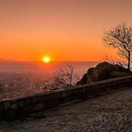 Sunset tree by DC Photos - Novices Only Landscapes ( plovdiv, hill, tree, sunset, cityscape, rocks, sun, bulgaria )