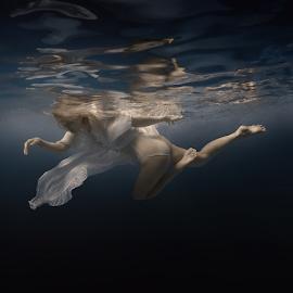 Dance of light by Dmitry Laudin - People Fashion ( beautiful, dress, woman, blue, white, light, underwater, dive, darkness, swim )