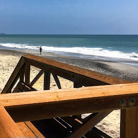Wooden Stairs Leading Down to a Nearly Deserted Beach by Eric Michaels - Landscapes Beaches ( sand, wood, afternoon, california, ocean, beach, doheny beach, figure, stairs, sky, dana point, woman, sunny, sunshine, surf )