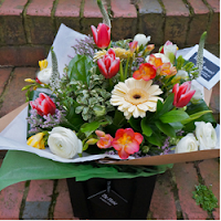 Seasonal reds and creams hand tied bouquet - The Florist Tunbridge Wells