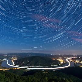 Predikaloszek in Hungary by Péter Mocsonoky - Landscapes Starscapes ( sky, startrails, forest, curve, nature, night, danube, duna, stars, predikaloszek, hungary, blue, river )