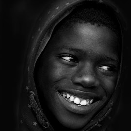 Happy in the township by Kim Stone - Black & White Portraits & People ( black and white, male, smile, teeth, portrait,  )
