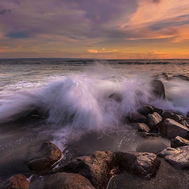 Sunset Splash by Choky Ochtavian Watulingas - Landscapes Sunsets & Sunrises ( clouds, boulders, splash, sunset, wave, seascape, rocks )