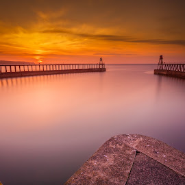 Whitby Sunset by Mark Heslington - Landscapes Sunsets & Sunrises ( shore, silk, uk, united, smooth, flat, sea, whitby, ocean, north, seascape, coastline, landscape, coast, england, kingdom, yorkshire, sunset, shoreline, golden )