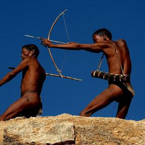 Bushmen on a rock by Rebecca Pollard - People Portraits of Men