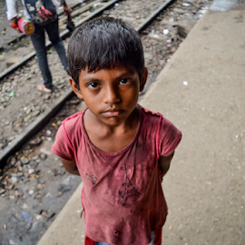 The Boy by Topu Saha - Babies & Children Child Portraits ( mymensingh, innocence, railroad, innocent, street, rail, topu saha, railway, bangladesh, people )