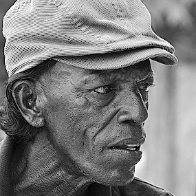 sweep ticket seller  by Nayana Nissanke - People Portraits of Men