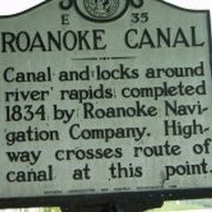 Canal and locks around river rapids completed 1834 by Roanoke Navigation Company. Highway crosses route of canal at this point.Plaque via North Carolina Highway Historical Marker Program, and is used ...