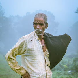 Standing alone by Jasraj Date - People Portraits of Men ( farmer, greenary, poverty, asia, india, forest, mountain top, rain )