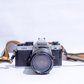 Nikon fm2 by Kama Rasul - Artistic Objects Technology Objects ( book, isolated, fm2, illustrative, lens, nikon, white, design, antique, camera, editorial, old, black, retro, equipment, film, analog, classic, vintage, background, silver, style, photography, object, fashion )