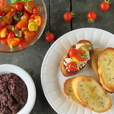 Cherry Tomato Salad With Baked Ricotta And Olive Tapenade Crostini